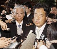 Transition talk: DPJ Secretary General Katsuya Okada answers questions Wednesday at the Prime Minister's Official Residence after he and DPJ policy chief Masayuki Naoshima (left) met with Chief Cabinet Secretary Takeo Kawamura.   KYODO PHOTO