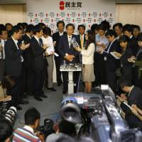 Center of attention: Yukio Hatoyama, president of the Democratic Party of Japan and the next prime minister, briefs the press at DPJ headquarters in Tokyo on Monday. | AP PHOTO