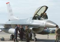 On the front lines: An F-16 fighter jet is serviced at Misawa Air Base in Aomori Prefecture in May 2005. | KYODO PHOTO