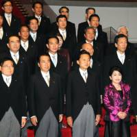 New kids on the block: Members of Prime Minister Yukio Hatoyama's new Cabinet gather Wednesday night at the Prime Minister's Official Residence. Hatoyama was sworn in earlier in the day as Japan's 93rd prime minister. | SATOKO KAWSAKI PHOTO