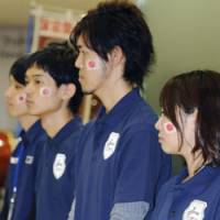 Towering failure: Disappointment shows on the faces of people who were rooting for Tokyo to host the 2016 Olympic Games at an event at Tokyo Tower early Saturday. | KYODO PHOTO