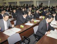 Only avenue: Ruling coalition lawmakers attend a policy committee session in the Land, Infrastructure, Transport and Tourism Ministry on Oct. 13. | KYODO PHOTO