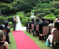 Dearly beloved: A couple read their wedding vows before guests in October at the International House of Japan in Minato Ward, Tokyo. | SATOKO KAWASAKI PHOTO