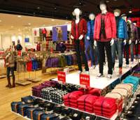 Rack 'em up: Uniqlo's third-largest store in Japan, located in the Sakae district of Naka Ward, Nagoya, sits ready for customers the day before its doors opened on Oct. 23. | KYODO PHOTO