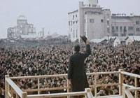 Weighty moment: Emperor Hirohito waves to a crowd during a visit in 1947 to a bombed-out Hiroshima in this scene from the documentary 'The Emperor and the Army.' | KAMI PRODUCTION / KYODO PHOTO