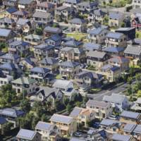 Keeping up with the Joneses: Solar panels have been installed on some 550 rooftops in the Pal Town neighborhood in Ota, Gunma Prefecture, where a government-supported study on how to ensure a steady supply of electricity is under way. | KYODO PHOTO