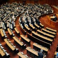 New leaders, old tactics: The Lower House plenary session approves a bill extending relief to previously uncertified victims of the 1945 atomic bombings of Hiroshima and Nagasaki, as the Liberal Democratic Party boycotts the vote.   KYODO PHOTO