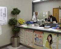 Lending a hand: A poster in a bank in Kurihara lets customers know that City Hall has set up a counseling phone line for debtors as part of efforts to prevent suicides. | AP PHOTO