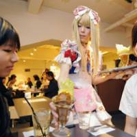 A maid man: A male dressed as a maid serves female customers at the Hibari-tei cafe in the Akihabara district in Tokyo. | KYODO PHOTO