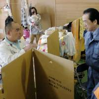 DinosIn the hot seat: A nuclear crisis evacuee who was exposed to high doses of radiation grills then Prime Minister Naoto Kan as he visits a shelter in Tamura, Fukushima Prefecture, in April. | KYODO PHOTO