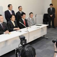 Party divisions: Nine renegade lawmakers who defected from the ruling Democratic Party of Japan hold a news conference in Tokyo on Wednesday after submitting their letters of resignation. | KYODO PHOTO