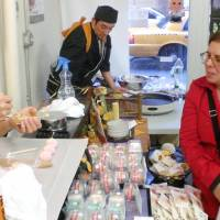 Tasty fare: Traditional Japanese sweets makers in Matsue sell their wares in New York on Dec. 26, as part of a project launched by local 'wagashi' makers and the Matsue Chamber of Commerce and Industry. | EXECUTIVE COMMITTEE OF CONFECTION MAKERS IN MATSUE