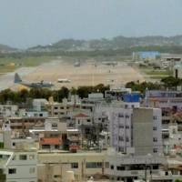 Bargaining chip: U.S. Marine Corps Air Station Futenma is seen in densely populated Ginowan, Okinawa Prefecture, last June. | KYODO