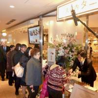 Weighing their options: People line up at a restaurant run by scale maker Tanita Corp. in Tokyo's Marunouchi district at the opening on Jan. 11. | KYODO
