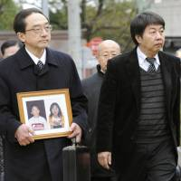 Bearing witness: Family members of people who were crushed to death after a 2001 fireworks show in Akashi, Hyogo Prefecture, enter the Kobe District Court Thursday to attend the trial of ex-Deputy Police Chief Kazuaki Sakaki, who was indicted for professional negligence in connection with the tragedy. | KYODO