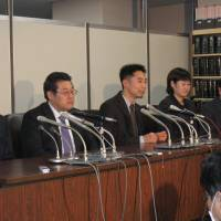 Presenting their case: People who have served as lay judges in Tokyo, Chiba and Miyagi prefectures hold a news conference at the Tokyo District Court on Thursday. | SETSUKO KAMIYA PHOTO
