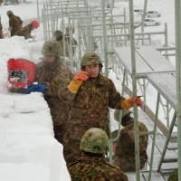 Snow job: Ground Self-Defense Force personnel in Hokkaido start work Saturday on giant snow sculptures for Asahikawa's winter festival, which starts Feb. 8 and will run for five days. | KYODO