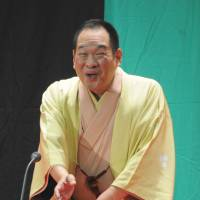 Mass appeal: Comic storyteller Katsura Kaishi gives a 'rakugo' performance in English at Shinagawa Joshi Gakuin girls' school in Tokyo on Dec. 16. | KYODO