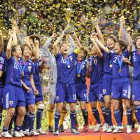 Most triumphant: Nadeshiko Japan captain Homare Sawa lifts the women's World Cup after the team beat the United States 3-1 on penalties on July 17. | KYODO