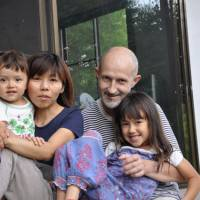 Support group: Aidan O'Connor poses with his son, Leo, wife, Humio, and daughter, Hotaru, at a friend's house in Kyoto in August. | COURTESY OF SAVE AIDAN.ORG