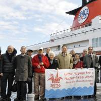Taking a stand: Atomic-bomb survivors and others gather in Yokohama port before departing Tuesday on a 100-day voyage to promote the abolishment of nuclear power and weapons. | KYODO