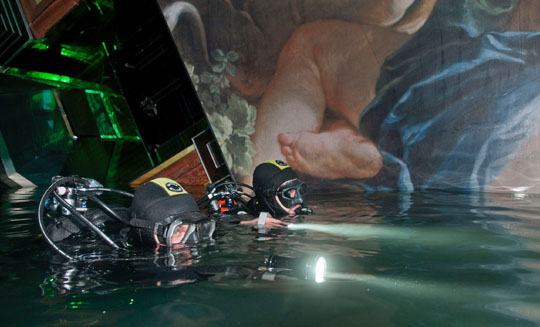 Scuba class: Divers search the Costa Concordia cruise ship off the Tuscan island of Giglio, Italy, on Jan. 24. | IRALIAN NAVY/AP