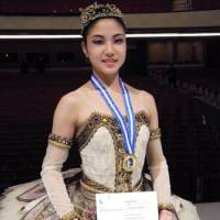 On the way up: Sporting a medal, Madoka Sugai holds her winners' certificate at the prestigious Prix de Lausanne ballet competition in Switzerland on Saturday. | KYODO