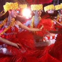 Flower power: Dancers perform Polynesian dances Monday during a rehearsal for the reopening Wednesday of Spa Resort Hawaiians in Iwaki, Fukushima Prefecture. | BLOOMBERG