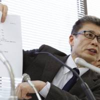 Signature event: Hajime Imai, secretary general of the group Let's Decide Together/Citizen-initiated National Referendum on Nuclear Power, faces reporters Thursday in Tokyo. | KYODO