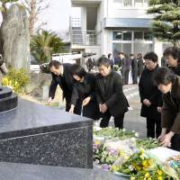 Maritime memorial: Relatives of the victims of the Ehime Maru sinking attend a service Friday in Uwajima, Ehime Prefecture, to mark the accident's 11th anniversary. | KYODO