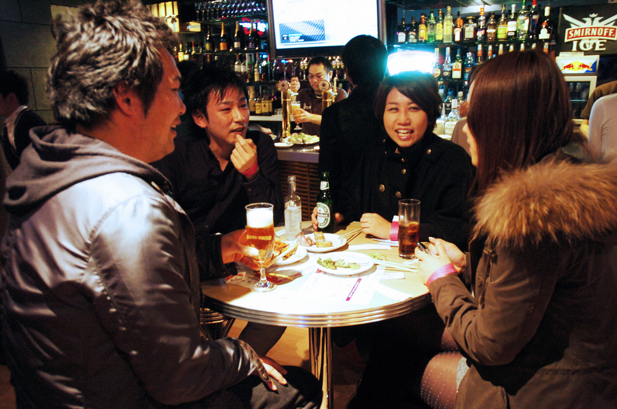 Getting to know you: Single men and women chat over drinks at Queen's, a dining bar in Tokyo's Meguro district, during a 'machikon' matchmaking party on Feb. 4. | KYODO
