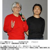 Movie message: Atsushi Funahashi (right), director of the documentary 'Nuclear Nation,' and Ryuichi Sakamoto, who composed music for the film, field questions from the audience at the Berlin International Film Festival on Sunday.   KYODO