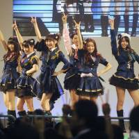 Skirt diplomacy: Members of all-girl idol group AKB48 perform during a special event held Friday in Beijing to thank China for its support in the aftermath of the March 11 disasters. | KYODO