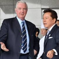 Right this way: Craig Reedie, chief of the International Olympic Committee's evaluation commission for the host city of the 2020 Games, is greeted by Tokyo Gov. Naoki Inose on his arrival at a Tokyo hotel Friday. | AFP-JIJI