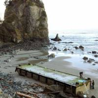 Voyage over: A dock from Aomori Prefecture set adrift by the 2011 tsunami is beached in Washington state in January. | KYODO