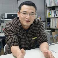 Called to action: Masaki Inaba, executive director of an umbrella alliance of civic groups tackling poverty in developing countries, is interviewed in Tokyo in December. | KYODO