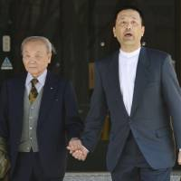 Retrial rejection: Shoji Maekawa exits the Nagoya High Court with his father, Reizo, on  Wednesday after his appeal for a retrial of his 1986 conviction over the slaying of a 15-year-old girl was turned down.   KYODO