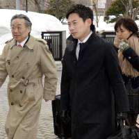 Unconstitutional but legal?: Lawyers enter the Sapporo High Court on Thursday ahead of a ruling on vote disparities. | KYODO