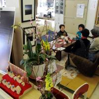 Some of the 140 evacuees from Futaba, Fukushima Prefecture, relax in a makeshift tea room set up in the former Kisai High School building in Kazo, Saitama Prefecture. | SATOKO KAWASAKI