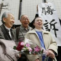 Polling for her: Plaintiff Takumi Nagoya celebrates Thursday with her parents and supporters outside the Tokyo District Court after it sided with her claim that the guardianship system under the Public Offices Election Law is unconstitutional. | KYODO