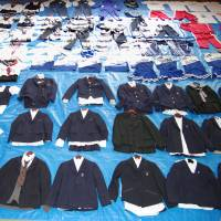 Collared: Around 90 high school girls' uniforms and jerseys confiscated from the home of Yasushi Uehara, 40, are displayed by the Kanagawa Prefectural Police. | KYODO