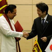 Shared concerns: Sri Lankan President Mahinda Rajapaksa meets Thursday with Prime Minister Shinzo Abe in Tokyo. | AFP-JIJI