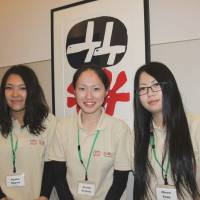 Moving on: Tohoku residents Ayako Ogawa, Atsuko Arimoto and Minori Endo pose at an event held by the Beyond Tomorrow Global Fund for Education Assistance program in Tokyo on March 9. | KYODO