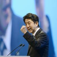 Read my lips: Prime Minister Shinzo Abe addresses the Liberal Democratic Party's annual convention in Tokyo on Sunday.   KYODO