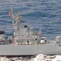 Lock and load: A Chinese frigate directs its fire-control radar at a Maritime Self-Defense Force destroyer near the disputed Senkaku Islands in January.   KYODO