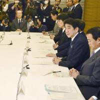 Okinawa matters: Prime Minister Shinzo Abe and his Cabinet discuss the government's Okinawa policies Tuesday in Tokyo with Okinawa Gov. Hirokazu Nakaima (second from left) present. | KYODO
