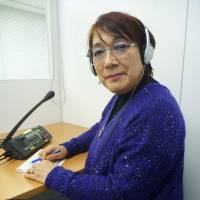 Go-between: Mariko Nagai, an English-Japanese interpreter with nearly 40 years of experience, works in Tokyo on Dec. 25. | KYODO