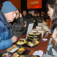 I'll take a hot dog: A customer talks to a shop clerk selling 'ekiben' boxed lunches Tuesday at New York's Grand Central Terminal, which is holding a special Japan Week event through Thursday. | KYODO
