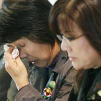 Technicality knockout: Sadako Iwamura, 63, weeps Thursday after a Fukuoka District Court branch ruled against the suit she and scores of others were pursuing against Kanemi Soko K.K. over a 1968 mass food poisoning in Kitakyushu. | KYODO