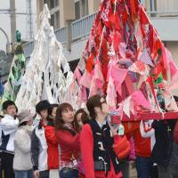 Fine art: The start of the Setouchi International Art Festival, a triennial contemporary art event, is celebrated with 'mikoshi' portable shrines  Wednesday in Naoshima, Kagawa Prefecture. | KYODO